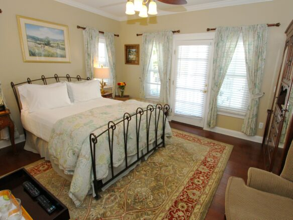 Wide of Rebecca Room with wrought iron bed
