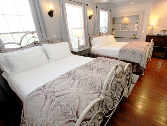 two double beds in a large room