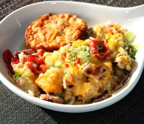 Country skillet scramble with egg, ham and oinions.