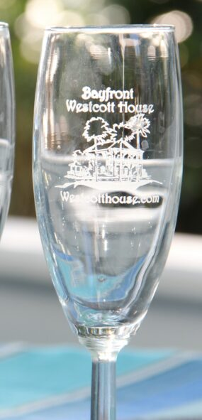 Pair of champagne flutes etched with Bayfront Westcott House on them.