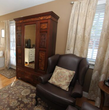 room armoire and comfortable chair