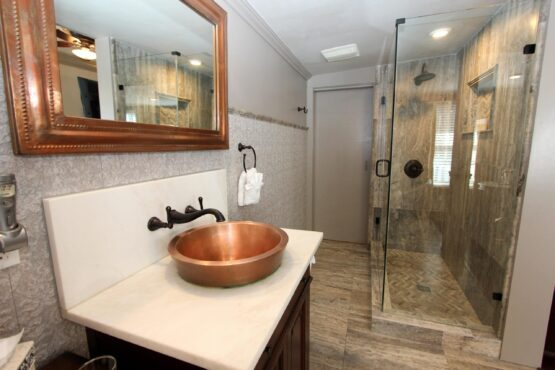 vanity with copper sink and shower