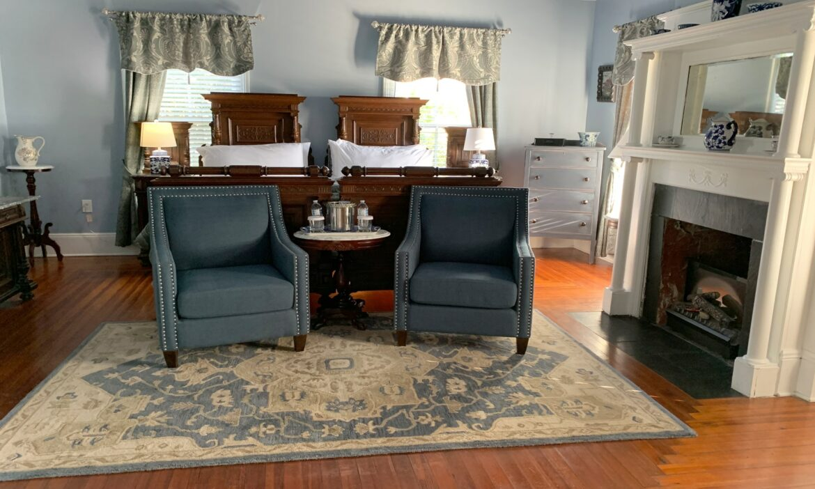 Wide of Menendez Room with fireplace and comfortable chairs