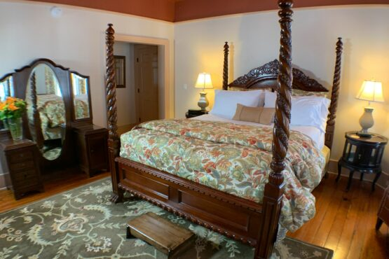 Anastasia room with king four poster bed and mirrored vanity.