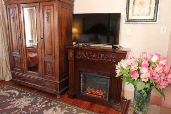 Anastasia room armoire and fireplace