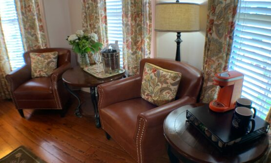 Anastasia room seating area. Two comfortable chairs, table with coffee service.
