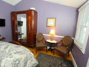 Abigail room armoire and seating area
